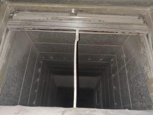 Fire damper held open with steel rod