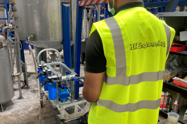 Hydro-X employee with Test and Trial Filtration Rig